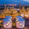 industrial oil and gas LPG refinery industry and commercial storage facilities import and export international by sea transport vessels aerial view at night in Thailand
